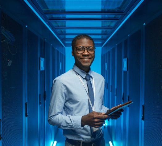 Smiling African American Man in Data Center